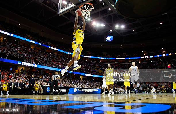 Jimmy Butler of the Marquette Golden Eagles goes up for a dunk against the Xavier Musketeers during the second round of the 2011 NCAA men's...