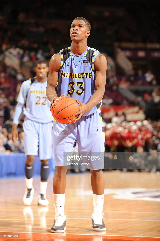 Jimmy Butler of the Marquette Golden Eagles takes a foul