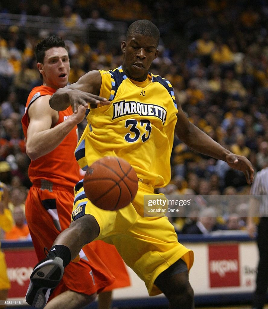 Jimmy Butler of the Marquette Golden Eagles tries to control