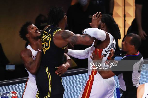 Jimmy Butler of the Miami Heat and Dwight Howard of the Los Angeles Lakers get into an altercation during the first quarter in Game Five of the 2020...