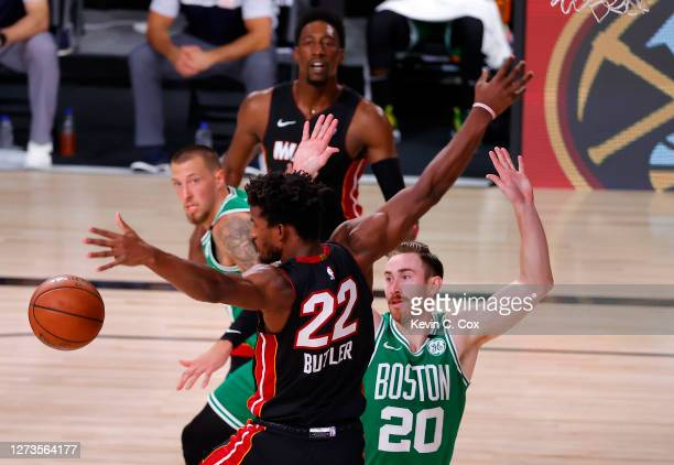 Jimmy Butler of the Miami Heat and Gordon Hayward of the Boston Celtics fight for a loose ball during the second quarter in Game Three of the Eastern...