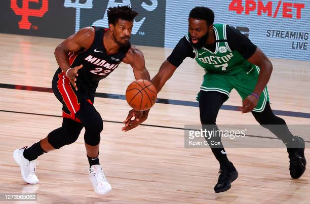 Jimmy Butler of the Miami Heat and Jaylen Brown of the Boston Celtics fight for a loose ball during the second quarter in Game Three of the Eastern...