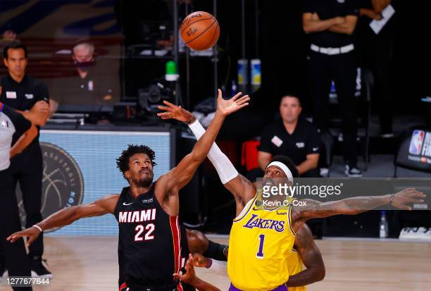 Jimmy Butler of the Miami Heat and Kentavious CaldwellPope of the Los Angeles Lakers fight for possession during the second quarter in Game One of...