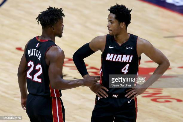 Jimmy Butler of the Miami Heat and KZ Okpala of the Miami Heat stand on the court during the first half of an NBA game against the New Orleans...