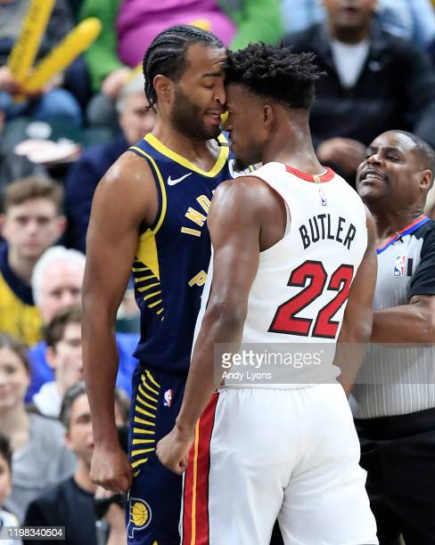 Jimmy Butler of the Miami Heat and TJ Warren of the Indiana Pacers get involved in an argument during the game at Bankers Life Fieldhouse on January...