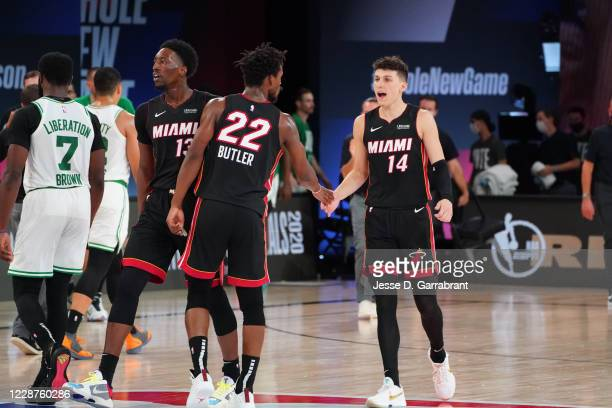 Jimmy Butler of the Miami Heat and Tyler Herro of the Miami Heat react during Game Six of the Eastern Conference Finals of the NBA Playoffs on...