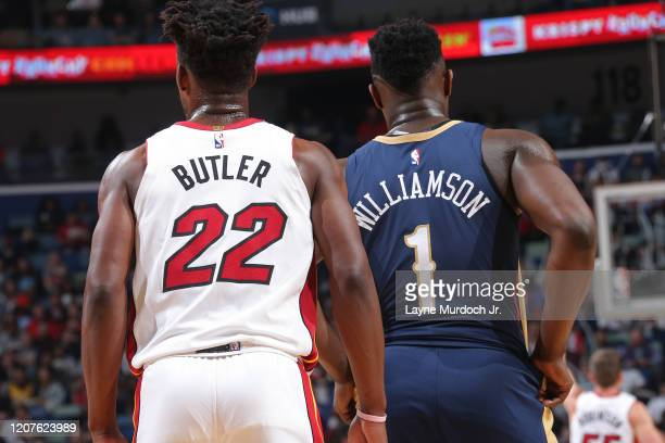 Jimmy Butler of the Miami Heat and Zion Williamson of the New Orleans Pelicans looks on during the game on March 6 2020 at the Smoothie King Center...