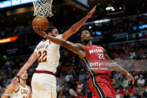 Jimmy Butler of the Miami Heat attempts a layup against Larry Nance Jr #22 of the Cleveland Cavaliers during the second half at American Airlines...