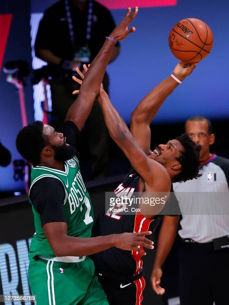 Jimmy Butler of the Miami Heat attempts a shot over Jaylen Brown of the Boston Celtics during the third quarter in Game Three of the Eastern...