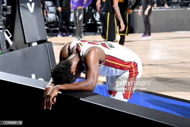 Jimmy Butler of the Miami Heat Bends rests over the signage in exhaustion during the game against the Los Angeles Lakers during Game Five of the NBA...