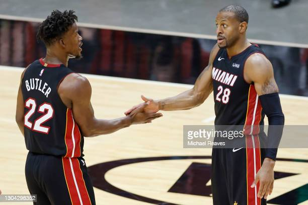Jimmy Butler of the Miami Heat celebrates with Andre Iguodala against the Utah Jazz during the fourth quarter at American Airlines Arena on February...