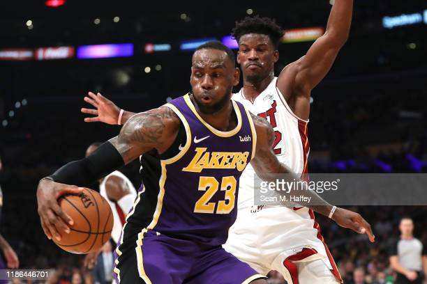 Jimmy Butler of the Miami Heat defends against LeBron James of the Los Angeles Lakers during the second half of a game at Staples Center on November...