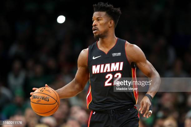 Jimmy Butler of the Miami Heat dibbles during the first half of the game between the Boston Celtics and the Miami Heat at TD Garden on December 04...