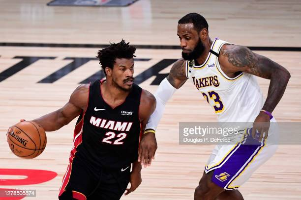 Jimmy Butler of the Miami Heat dribbles against LeBron James of the Los Angeles Lakers during the second half in Game Three of the 2020 NBA Finals at...