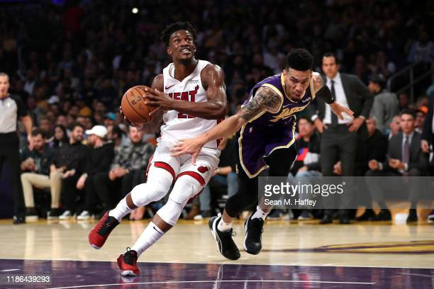 Jimmy Butler of the Miami Heat dribbles past Danny Green of the Los Angeles Lakers during the first half of a game at Staples Center on November 08...