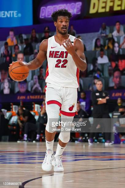 Jimmy Butler of the Miami Heat dribbles the ball against the Los Angeles Lakers during Game Five of the NBA Finals on October 9, 2020 in Orlando,...