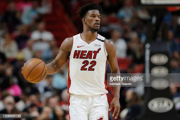 Jimmy Butler of the Miami Heat dribbles with the ball against the Minnesota Timberwolves during the second half at American Airlines Arena on...