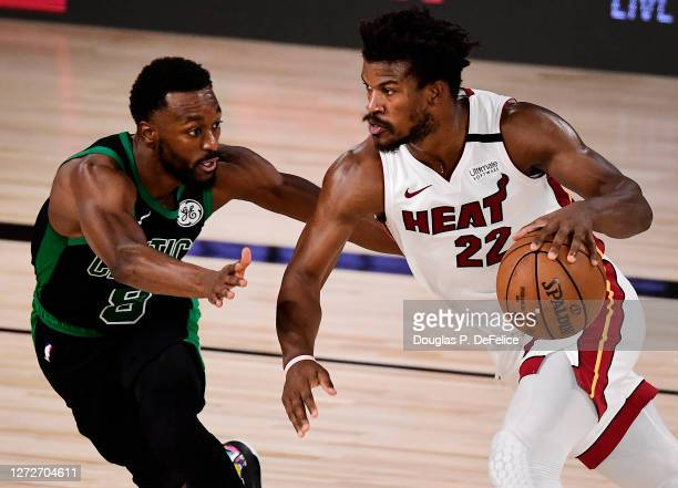 Jimmy Butler of the Miami Heat drives the ball against Kemba Walker of the Boston Celtics during the fourth quarter in Game One of the Eastern...