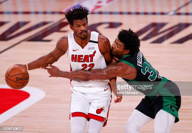 Jimmy Butler of the Miami Heat drives the ball against Marcus Smart of the Boston Celtics during the first quarter in Game Five of the Eastern...