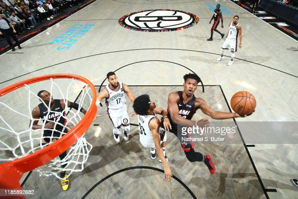 Jimmy Butler of the Miami Heat drives to the basket against the Brooklyn Nets on December 1, 2019 at Barclays Center in Brooklyn, New York. NOTE TO...