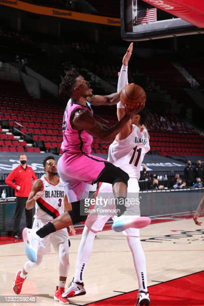 Jimmy Butler of the Miami Heat drives to the basket during the game against the Portland Trail Blazers on April 11, 2021 at the Moda Center Arena in...