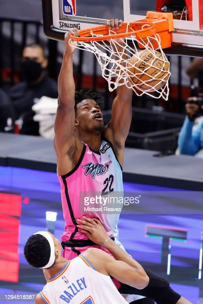 Jimmy Butler of the Miami Heat dunks against the Oklahoma City Thunder during the second quarter at American Airlines Arena on January 04, 2021 in...