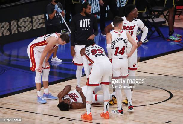 Jimmy Butler of the Miami Heat goes down hard as teammates look on during the third quarter against the Los Angeles Lakers in Game Five of the 2020...