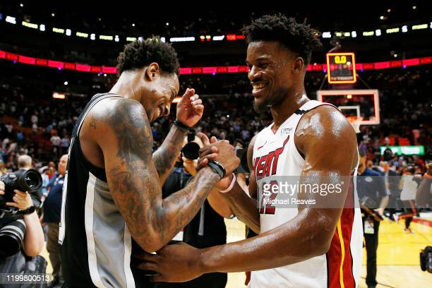 Jimmy Butler of the Miami Heat greets DeMar DeRozan of the San Antonio Spurs after the game at American Airlines Arena on January 15 2020 in Miami...
