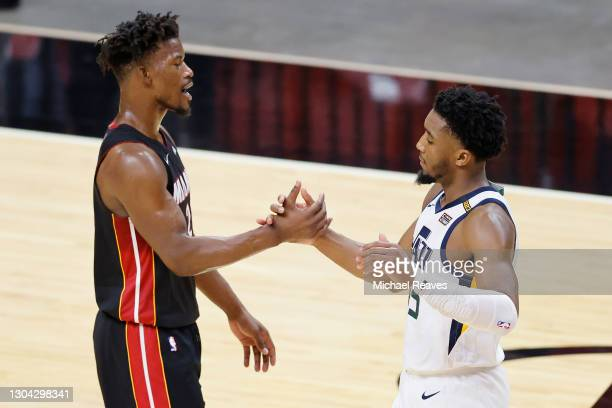 Jimmy Butler of the Miami Heat greets Donovan Mitchell of the Utah Jazz after the game at American Airlines Arena on February 26, 2021 in Miami,...