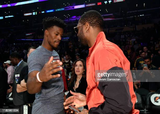 Jimmy Butler of the Miami Heat greets former Miami Heat player Dwyane Wade before the start of the game against the Los Angeles Lakers at Staples...