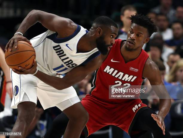 Jimmy Butler of the Miami Heat guards Tim Hardaway Jr. #11 of the Dallas Mavericks in the second half at American Airlines Center on December 14,...
