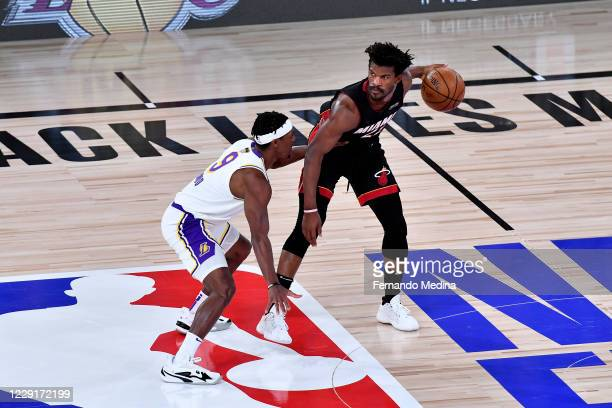 Jimmy Butler of the Miami Heat handles the ball against Rajon Rondo of the Los Angeles Lakers during Game Six of the NBA Finals on October 11, 2020...