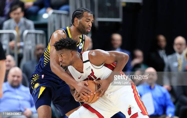 Jimmy Butler of the Miami Heat is defended by TJ Warren of the Indiana Pacers during the game at Bankers Life Fieldhouse on January 08 2020 in...