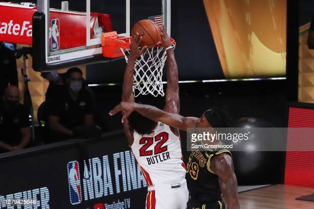 Jimmy Butler of the Miami Heat is fouled by Dwight Howard of the Los Angeles Lakers during the third quarter in Game Five of the 2020 NBA Finals at...