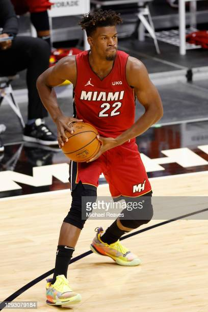 Jimmy Butler of the Miami Heat looks to pass against the New Orleans Pelicans during the second quarter at American Airlines Arena on December 25,...