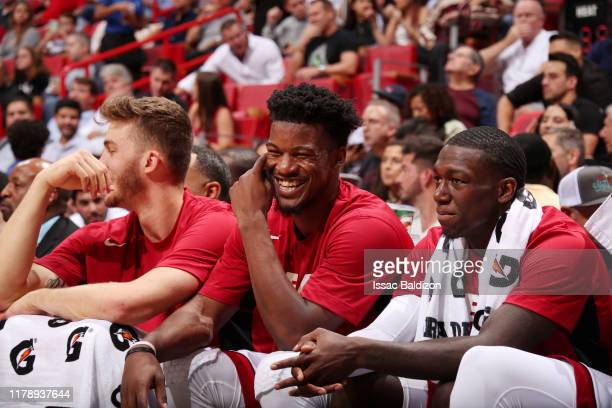 Jimmy Butler of the Miami Heat Meyers Leonard of the Miami Heat and Kendrick Nunn of the Miami Heat look on during the game against the Atlanta Hawks...