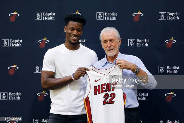 Jimmy Butler of the Miami Heat poses for a photo with president Pat Riley during his introductory press conference at American Airlines Arena on...