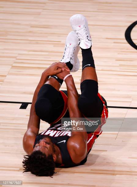 Jimmy Butler of the Miami Heat reacts after coming down hard after a play during the second quarter against the Los Angeles Lakers in Game One of the...