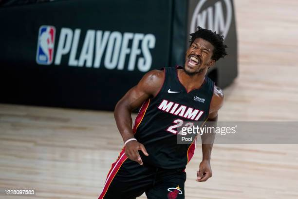 Jimmy Butler of the Miami Heat reacts after dunking against the Indiana Pacers during the second half at AdventHealth Arena at ESPN Wide World Of...
