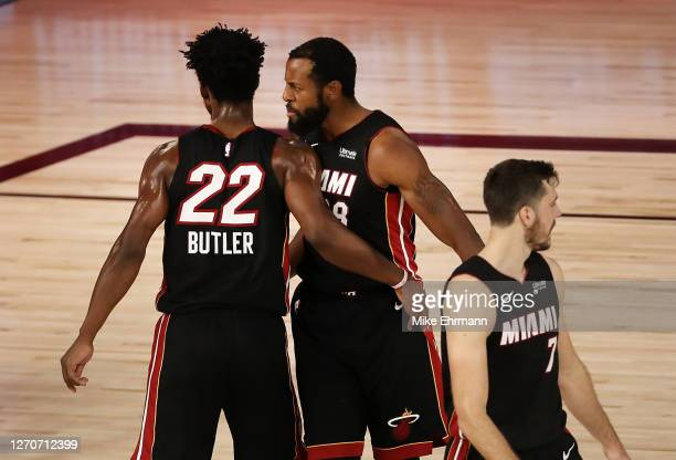 Jimmy Butler of the Miami Heat reacts with teammates during the fourth quarter after their win against the Milwaukee Bucks in Game Three of the...