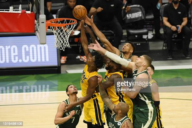 Jimmy Butler of the Miami Heat shoots in the second quarter against Giannis Antetokounmpo of the Milwaukee Bucks during Game 1 of their Eastern...