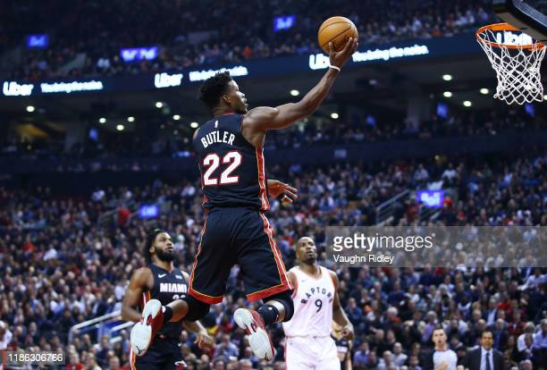 Jimmy Butler of the Miami Heat shoots the ball during the first half of an NBA game against the Toronto Raptors at Scotiabank Arena on December 03...