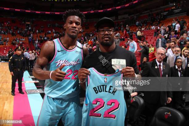 Jimmy Butler of the Miami Heat signs autographed jersey for NFL superstar Von Miller after the game against the Orlando Magic on January 27, 2020 at...