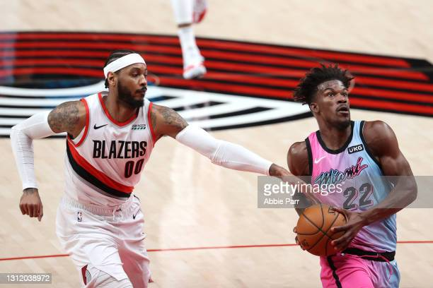 Jimmy Butler of the Miami Heat works towards the basket against Carmelo Anthony of the Portland Trail Blazers in the second quarter at Moda Center on...
