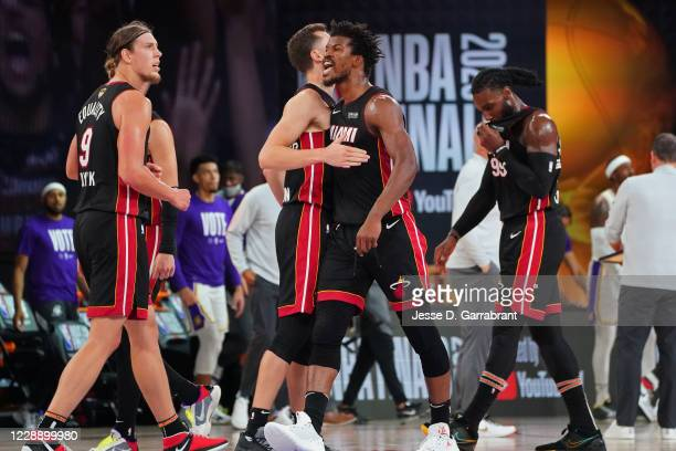Jimmy Butler of the Miami Heat yells and celebrates as he walks up court against the Los Angeles Lakers during Game Three of the NBA Finals on...