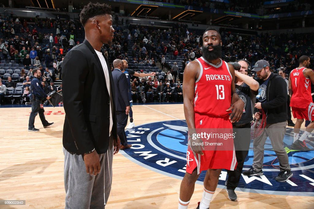 Jimmy Butler 23 of the Minnesota Timberwolves and James Harden 13 of the Houston