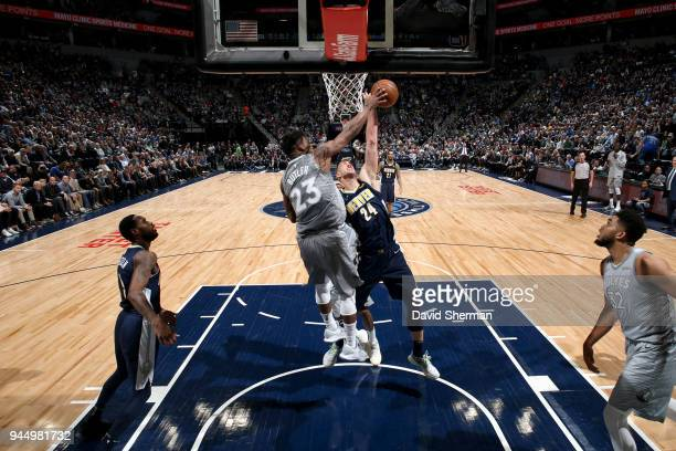 Jimmy Butler of the Minnesota Timberwolves blocks the shot of Mason Plumlee of the Denver Nuggets on April 11 2018 at Target Center in Minneapolis...