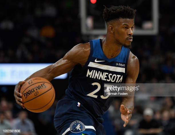 Jimmy Butler of the Minnesota Timberwolves dribbles the ball against the Cleveland Cavaliers during the fourth quarter of the game on October 19 2018...