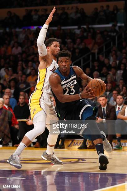 Jimmy Butler of the Minnesota Timberwolves drives to the basket while being defended by Josh Hart of the Los Angeles Lakers during the first half of...