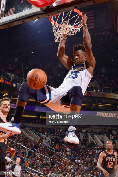 Jimmy Butler of the Minnesota Timberwolves dunks the ball against the Phoenix Suns on December 23 2017 at Talking Stick Resort Arena in Phoenix...